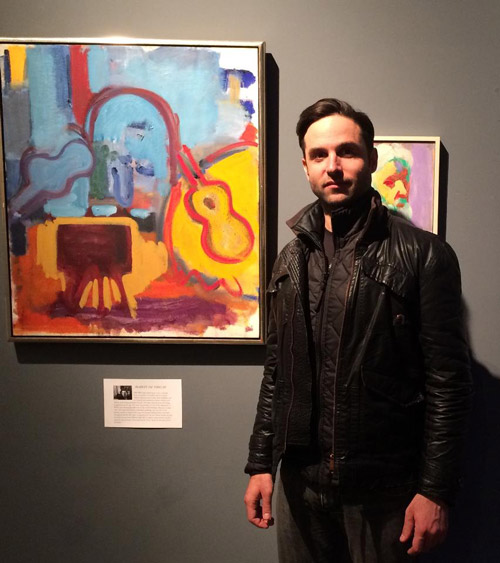 Tyler Loftis with the Robert DeNiro Sr. painting 'Blue & Yellow Interior'